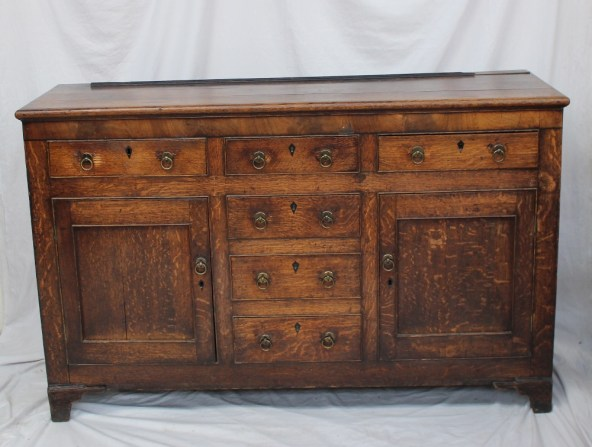 An 18th century oak dresser base. Sold for £490 at Anthemion Auctions