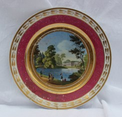 A Russian porcelain cabinet plate transfer and infil decorated with a view of Tauride palace, within a gilt and marbled pink border, inscribed verso, 24cm diameter. Sold for £620 at Anthemion Auctions