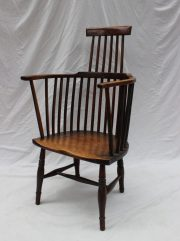 A late 18th century yew Welsh comb back armchair, with a raised back, hoop shaped arms and a solid seat on turned legs. Sold for £700 at Anthemion Auctions