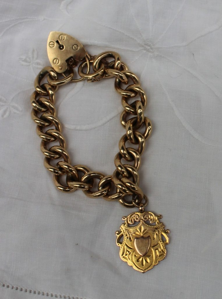A 9ct yellow gold bracelet with padlock clasp and medallion approximately 68 grams. Sold for £540 at Anthemion Auctions