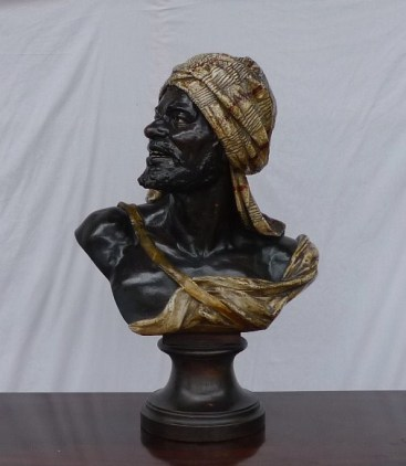 A terracotta bust of an Arabian figure with a headdress marked Giesecke. Sold for £850 at Anthemion Auctions
