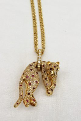 A diamond and ruby leopard pendant. Sold for £1,800 at Anthemion Auctions