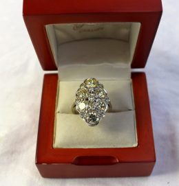 A diamond cluster ring with fifteen brilliant cut diamonds totaling approx. 4cts. Sold for £1,600 at Anthemion Auctions