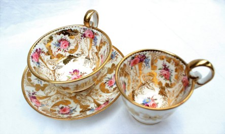 A Nantgarw porcelain trio, with a tea cup, coffee cup and saucer, each with a scalloped gilt rim, gilt swags and twin handled vases, painted with roses and other garden flowers. Sold for £1,400 at Anthemion Auctions