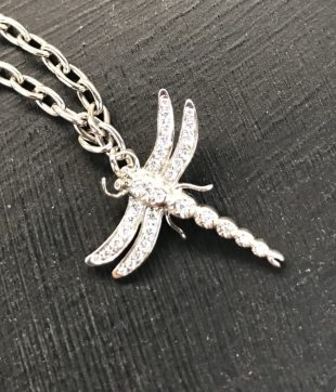 """Sold for £1,300 A Tiffany & Co., platinum """"Dragonfly"""" charm bracelet, set with round brilliant cut diamonds, 0.12cts total weight, 15cm long, approximately 8 grams, boxed, plus additional links. The dragonfly is 2cm x 2cm, and each additional link is approximately 5mm long"""