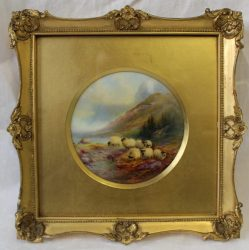 Lot 229 - Sold for £1,400 - A Royal Worcester porcelain plaque of circular form, painted with sheep by a lock with mountains beyond, signed by Harry Davis, puce mark and date code for 1915, in a gilt frame, 10.5cm diameter