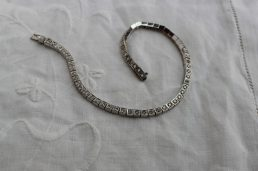 A diamond set tennis bracelet, set with sixty round brilliant cut diamonds to box settings in 18ct white gold, approximately 12 grams