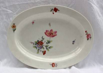 A Swansea porcelain dish of oval form painted with sprays of garden flowers, impressed mark and trident, 35.5cm wide, Sir Leslie Joseph Collection Swansea No.442 label verso Sold for £310 at Anthemion Auctions