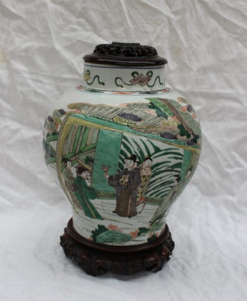 A Chinese porcelain baluster vase decorated with figures in a landscape, cornucopia mark to the base, 31cm high. Sold for £480 at Anthemion Auctions