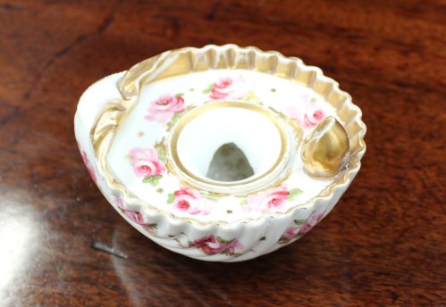 A Swansea porcelain shell inkwell painted with roses and leaves, unmarked, 10.5cm wide. Sold for £350 at Anthemion Auctions