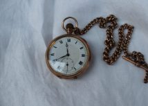 Lot 43 - Sold for £680 - A 9ct yellow gold keyless wound open faced pocket watch, the circular dial with Roman numerals and a seconds subsidiary dial together with a 9ct yellow gold albert chain, approximately 45 grams, 34.5cm long