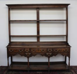 An 18th century South Wales oak dresser, the open rack with a moulded cornice above two shelves. Sold for £1,250 at Anthemion Auctions