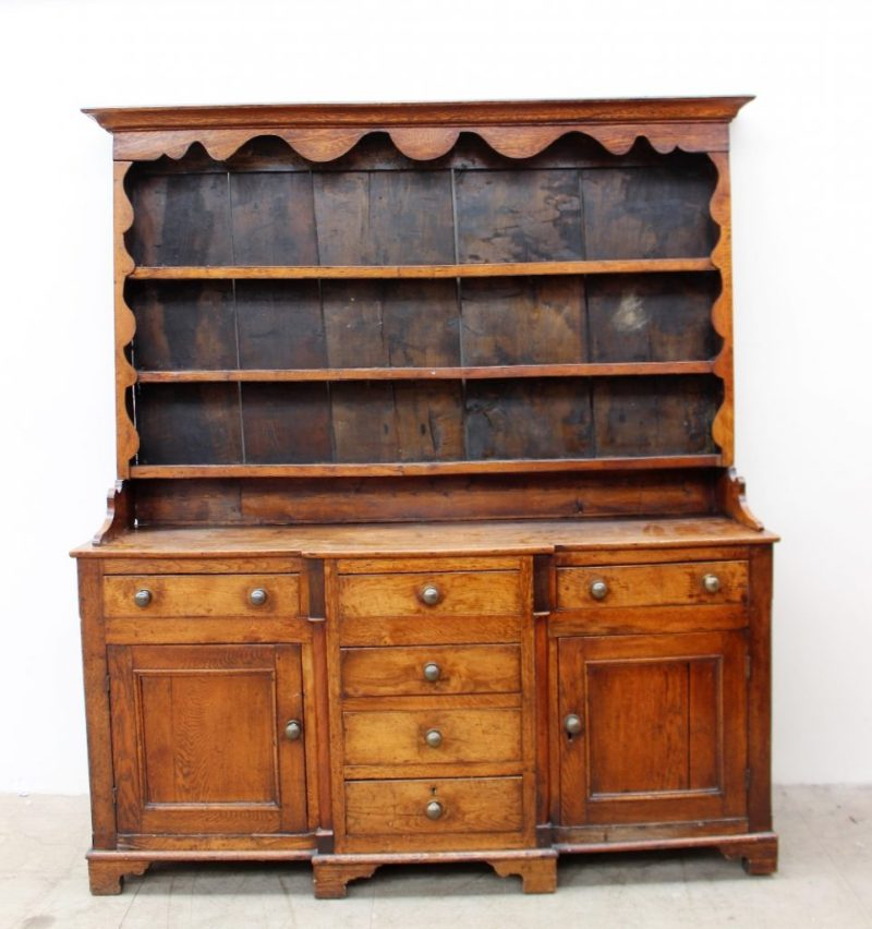 An 18th century North Wales oak dresser, the rack with the moulded cornice above a shaped frieze and three shelvesLot 431 in our February 21st Fine Sale