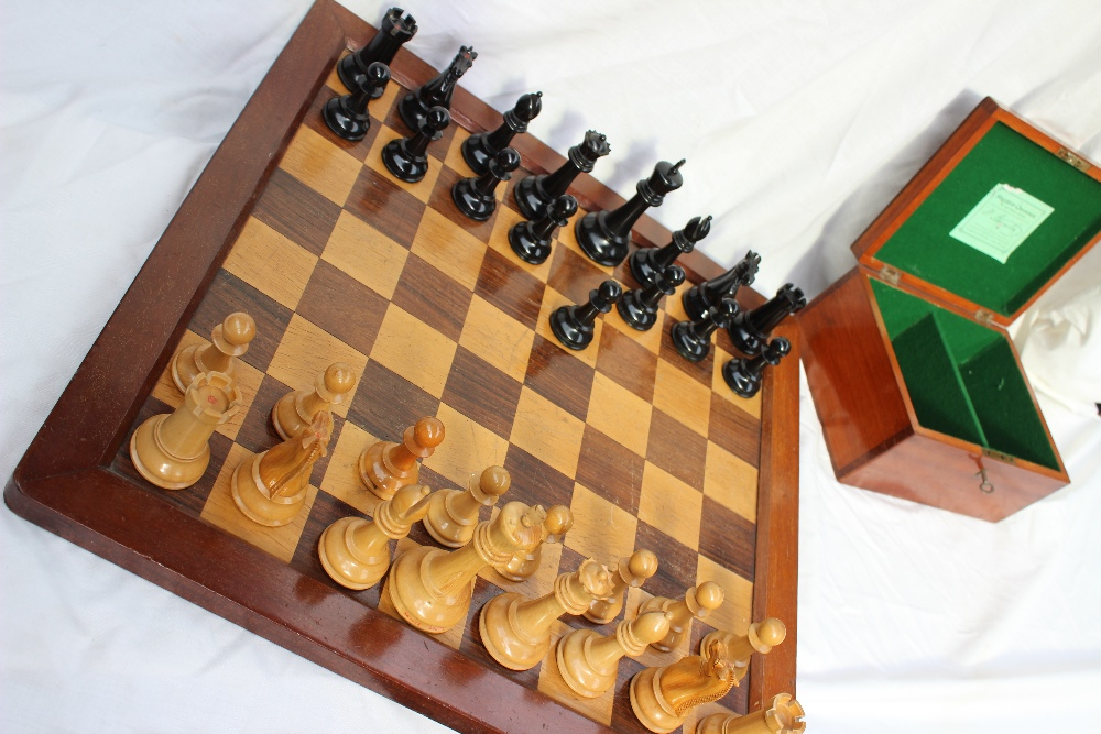 A Staunton pattern boxwood and ebony chess set by Jaques & Son, the white king stamped `JAQUES LONDON`. Sold for £1,500 at Anthemion Auctions