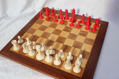 A Staunton pattern ivory chess set by Jaques & Son, the white king stamped `JAQUES LONDON`, with black crown marks to two knights and two rooks. Sold for £500 at Anthemion Auctions