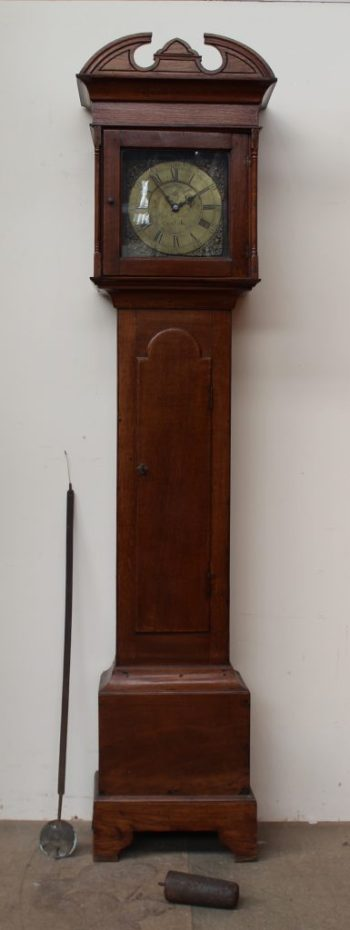 A 19th century oak longcase clock, the arched hood with shallow pillars above a long trunk door, box base and bracket feet. Sold for £680 at Anthemion Auctions