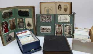 A large collection of postcards some loose and in albums. Sold for £780 at Anthemion Auctions