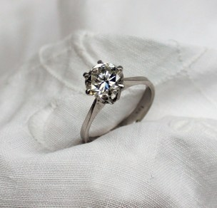 A solitaire diamond ring the brilliant cut diamond approximately 1.5 carats, to an 18ct white gold six claw setting and shank, size N. Sold for £1,950 at Anthemion Auctions
