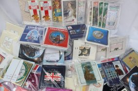 Lot 94 - Sold for £490 - A large collection of United Kingdom uncirculated coin collections, various dates, coins etc in original packaging including 2002, 1989 £2 coins, 1988 £1 coins, commemorative crowns, 1996 £2 coin, 2000 £5 coin, 2003 collection, 2005 collection etc