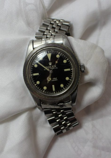 """A gentleman's Rolex Submariner bracelet watch, with a circular black dial, luminous hour markers and silver/luminous hands and seconds sweep, the dial inscribed """"Rolex Oyster Perpetual 100m=330ft Submariner Swiss T 25"""" to a stainless steel case (bezel missing) to an oyster link style bracelet. Model number 6536-1, case reference 306396. Sold for £4,200 at Anthemion Auctions"""