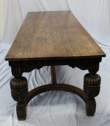 A 17th century style oak refectory table, the planked moulded rectangular top above a carved frieze on cup and cover legs united by a flat stretcher, 245cm long, 91 cm wide. Sold for £1,200 at Anthemion Auctions