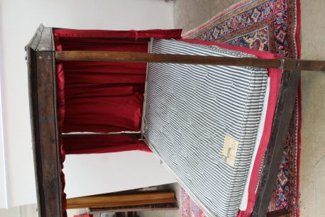 An 18th century oak four poster bed, with a moulded cornice above a shallow frieze, the front tapering cylindrical uprights and rear rectangular uprights, 196cm long x 132cm wide x 192cm high. Sold for £1,000 at Anthemion Auctions