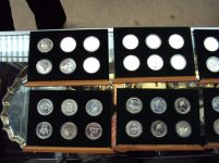 A set of forty eight Royal mint white metal and silver coins, contained within two four drawer chests Sold for £220 at Anthemion Auctions