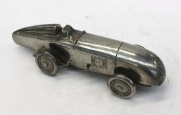 An Art Deco style desk lighter in the form of a Magic MG Midget, marked to the underside Enturn Pewter PAT No 373219, Made in England, 20 cm long. Sold for £820 at Anthemion Auctions