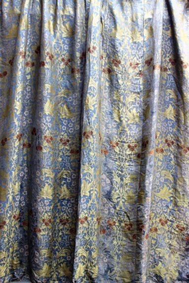 A pair of William Morris design curtains, decorated with fruit and flowers 250cm x 280cm together with assorted linen. Sold for £900 at Anthemion Auctions