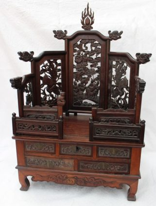 A Chinese hardwood table top shrine, with carved panels, and an arrangement of five drawers on shaped feet, 78cm high x 49.5cm wide x 33cm deep. Sold for £3,100 at Anthemion Auctions