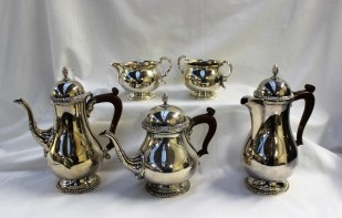 An Elizabeth II silver five piece tea and coffee set, comprising a teapot, coffee pot, hot water jug, cream jug and twin handled sugar bowl, Birmingham, 1968, Barker Ellis Silver Co, approximately 2353. Sold for £760 at Anthemion Auctions