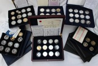 A large collection of silver coins and coin sets including Charles Darwin, silver coin presentation cover, 250th anniversary of the birth of Nelson, farewell to the QE2, The Captain James Cook, various silver crowns five pound coins, etc . Sold for £720 at Anthemion Auctions
