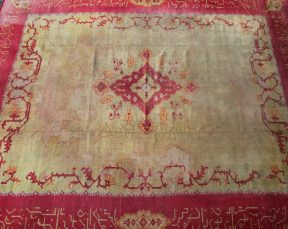 An early 20th century Turkish rug, with a red and yellow ground with stylised flower heads and leaves, approximately 437 x 368cm. Sold for £700 at Anthemion Auctions