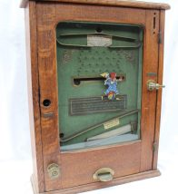 """The """"Clown"""" Pickwick - An oak cased coin operated arcade game, No.572B Patent No.23431/1900, 46.5cm wide x 60.5cm high. Sold for £680 at Anthemion Auctions"""