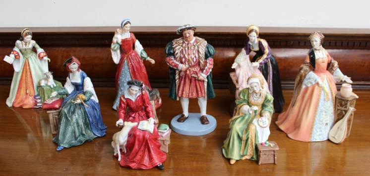 A set of seven Royal Doulton figures including King Henry VIII HN3458, No.993/9500, Catherine of Aragon HN3233 No.760/9500, Anne Boleyn HN3232 No.4220/ 9500, Jane Seymour HN3349, No. 3076/ 9500 Anne of Cleves, HN3356 No.3140/9500, Catherine Howard HN3449 No. 3096/9500, and Catherine Parr HN3450, No 2970/9500 and another Royal Doulton figure Lady Jane Grey HN3680, No. 2349/5000. Sold for £750 at Anthemion Auctions