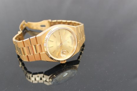 """A gentleman's 18ct yellow gold wristwatch, the yellow metal dial with batons, day and date marked """"Rolex oyster quartz Day-Date, superlative chronometer"""" marked to the reverse 19018, 6405298 . Sold for £3,900 at Anthemion Auctions"""