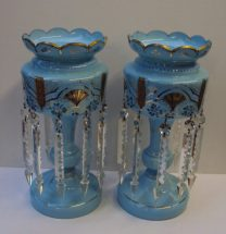 A pair of blue glass table lustres with a shaped top on a baluster column and spreading foot 38 cms high. Sold for £260 at Anthemion Auctions