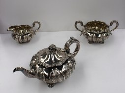 A William IV silver three piece teaset of melon shape, with leaf and flower decoration, London, 1830, Joseph Angell, approximately 1443 grams. Sold for £820 at Anthemion Auctions