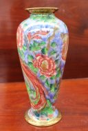 "A Wedgwood porcelain lustre vase designed by Daisy Makeig-Jones, of ovoid form decorated in the ""Argus Pheasant"" pattern, printed mark and painted Z5486, 26.5cm high. Sold for £900 at Anthemion Auctions"