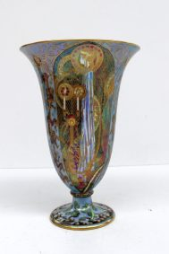 A Wedgwood fairyland lustre trumpet vase designed by Daisy Makeig-Jones, decorated in the Candlemas pattern, against a blue ground, the interior decorated with flower heads and leaves, the exterior decorated with panels of figures and candles within a pale green ground with all over gilt and painted decoration, the base with printed mark and painted Z5157, 21.5cm high. Sold for £3,100 at Anthemion Auctions