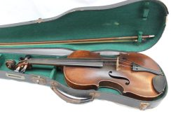 "A French violin, with a two piece back and ebonised stringing, bears a label ""Antonius Stradivarius cremona faciat anno 1690"""