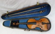An early 20th century violin, with a two piece back and ebonised stringing. Sold for £200 at Anthemion Auctions