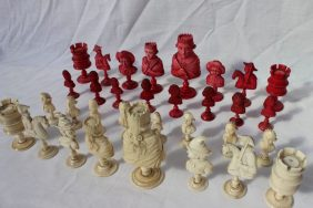 A late 18th / early 19th century French carved ivory and bone bust type chess set, possibly Dieppe, The kings and queens depicted as monarchs, holding sceptres, the bishops as fous, knights on horseback, rooks as turrets and the white pawns wearing frock coats, the red pawns as blackamoors, The king - 10.2cm high; the pawn 5cm high. Sold for £1,700 at Anthemion Auctions