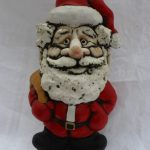 """A John Hughes pottery Father Christmas grogg, inscribed """"A Groggy Christmas to All"""", 21.5cm high. Sold for £45 at Anthemion Auctions"""