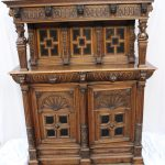 A 19th century Low Countries oak court cupboard, the moulded cornice above a shallow frieze with lions head terminals, three recessed geometric panelled doors held aloft by terminal figures, the base with two drawers with mask handles, and two cupboard doors on a plinth base, 161 cm wide by 65.5 cm deep by 202 cm high. Sold for £400 at Anthemion Auctions
