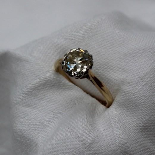 A Cushion cut solitaire diamond ring, approximately 2ct measuring approximately 7mm wide x 8mm high x 5mm deep, to a white metal claw setting and yellow metal shank marked 18ct & Plat. Sold for £2,500 at Anthemion Auctions