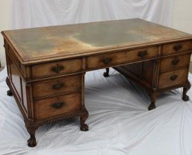 A 20th century walnut pedestal desk,the rectangular leather inset top above three drawers to the apron, each pedestal with two drawers on hairy lions paw feet, 183 cm long by 107 cm deep. Sold for £1,300 at Anthemion Auctions