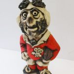 """A John Hughes pottery Grogg titled """"Pushover Pugh"""", depicting a rugby player in a Welsh shirt """"John Hughes 1976, Wales Grand Slam"""", 32cm high. Sold for £100 at Anthemion Auctions"""