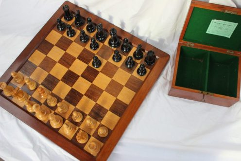 A Staunton pattern boxwood and ebony chess set by Jaques & Son, the white king stamped `JAQUES LONDON`, with red crown marks to two knights and two rooks, weighted bases, the king: 11cm high, the pawn: 5.5cm high, in a mahogany baize lined box with green trade label inscribed `THE Staunton Chessmen, TWO PRIZE MEDALS AWARDED, H. Staunton, Note this Signature, Without it none are Genuine. J. JAQUES & SON, LONDON, ENGLAND.`. together with a Jaques and Son chess board 50.5cm x 50.5cm. Sold for £1,500 at Anthemion Auctions