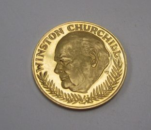"""A yellow metal coin produced to commemorate Winston Churchill with a portrait to one side and """"In memoriam 1874-1965"""" to the other approximately 10grams Sold for £200 at Anthemion Auctions"""